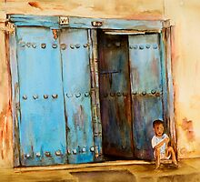Child sitting in old Zanzibar doorway by Sher Nasser