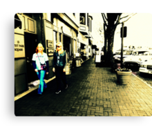 Movement on a city street at midday Canvas Print