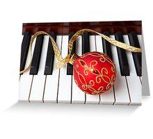 Christmas ornament on piano keys Greeting Card