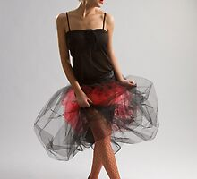 Beautiful girl in diaphanous skirt by fotorobs