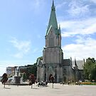 Kristiansand cathedral on sunny day with clear blue sky Norway by Grace Johnson