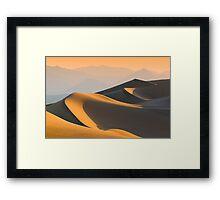 Sand dunes over sunrise sky in Death valley, California Framed Print