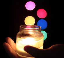 Hand holding a Candle  by Ronnie  Smith