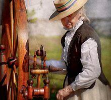Sewing - Weaving - Big wheel keep on turning  by Mike  Savad