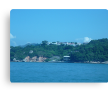 Mansions on top of island Canvas Print