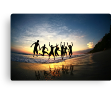 Group of Friends Jumping on Beach at Sunset Canvas Print