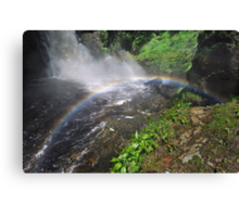 Bushkill waterfall with full spring water and rainbow at summer time Canvas Print