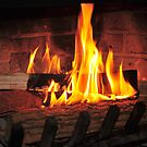 Burning fire at fireplace. Can be used as background. by Anton Oparin