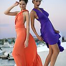 Two beautiful girls posing gorgeous on the deck of luxury yacht  by Anton Oparin