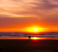 Strolling Lovers at Sunset   by Chuck Gardner
