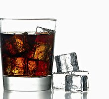 Fresh Cold Cola with ice in glass by Gert Lavsen