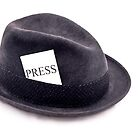 A photojournalist fedora hat with press card by Gert Lavsen