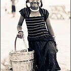 Little girl at the Goa beach by Neha Singh