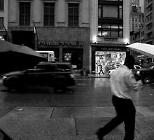 People walking in the rain by alanbuech