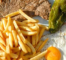 Fried egg, french fries, pepper and steak by alanbuech
