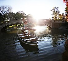 Acroyoga on a boat, Central Park, New York by Wari Om  Yoga Photography