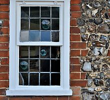 Window and flint wall by richard  webb