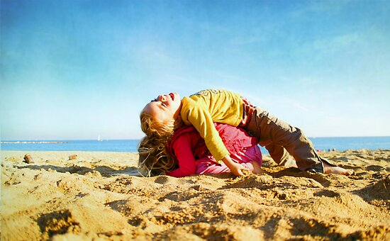 Kids in the beach, Barcelona by Wari Om  Yoga Photography