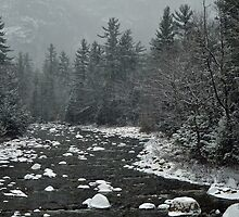 Winter first snow scenery with mountain river in White Mountains, NH by Anton Oparin