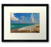 Beach chairs in a tropical pool in the Bahamas Framed Print