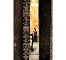 African boy in courtyard Stone Town Photographic Print