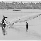 Fisherman on the backwaters of Kerala, India by photograham