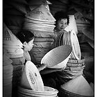 Hat Sellers, Hue City, Vietnam. by Karl Willson