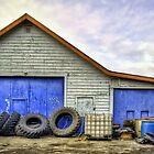 Tire Repair Shop by Myron Watamaniuk