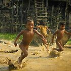 Playing at Kampong Khleang. by Karl Willson