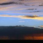 Sundown with rain and dark clouds... by Mauds