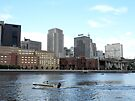 Speed Boating along side the city  - Minneapolis MN by Barberelli