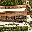 Snow Covered Shop From a Byone Era by Dale Lockwood