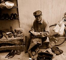 Old Vietnamese boot polisher by JLCampbell