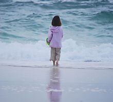 Young girl walking into waves by KSKphotography