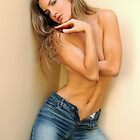 Fashion photo of young topless sensual woman in jeans by Anton Oparin