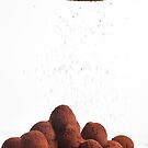 Chocolate truffles and cocoa powder  by PhotoStock-Isra