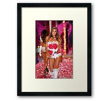 Victoria's Secret model Doutzen Kroes walks the runway Framed Print