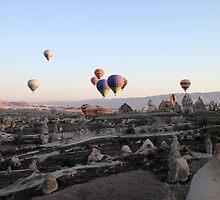 Hot air balloons over Cappadocia by Cláudia Fernandes