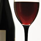 Wine red in a bottle and a glass. by larisa  fedotova