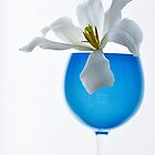 Flower white in a blue glass. by larisa  fedotova