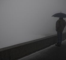 Man with umbrella looking out into the abyss by Michael Brewer