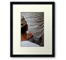 Stone carver at work in Batubulan, Bali, Indonesia. Framed Print