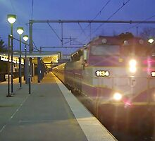 Lit Up Commuter Rail by Eric Sanford