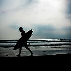 Silhouetted surfer in South Wales by bearmagrills