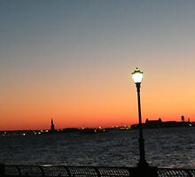 Statue of Liberty, Ellis Island, View from Lower Manhattan at Sunset by lenspiro