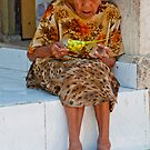 Old woman basket weaving on Nusa Penida, Bali, Indonesia by Michael Brewer
