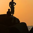Silhouetted Figures on Rock at Sunset Palolem by SerenaB