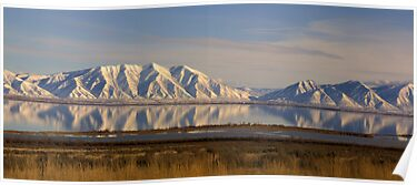 Snowy Mountains reflect in Utah Lake by Brian D. Campbell