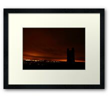 Towering in the night Framed Print