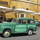green car in street by Anne Scantlebury
